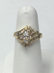 14K Yellow Gold Marquise and Baguette Wedding Ring Size 6 .43 ct Marquise .78 ct Baguettes Original Price: $3899 Sale Price: $1899