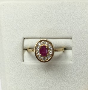 14K Yellow Gold Ruby with Diamond Halo Ring Size 7 .30 ct oval Ruby .50 ct diamonds Original price: $999 Sale price: $499