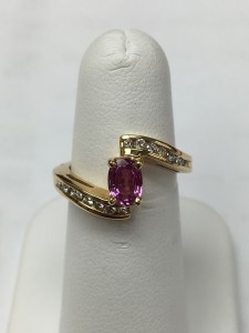 14K Yellow Gold Pink Sapphire and Diamond Fashion Ring Size 6.25 1 ct pink sapphire and .25 ct diamonds Original Price: $999 Sale Price: $499